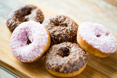 Close up of glazed donuts pile on table Stock Photos