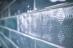 Close-up of a glossy ceramic blue tile with a pattern Stock Photo