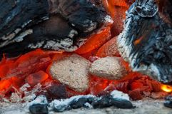 Close up of glow of embers. Burning embers, charcoal, coal and wood in a fite Stock Images