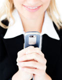 Close-up of a glowing businesswoman sending a text Stock Images