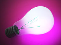 Close up of a glowing lightbulb Stock Images