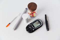 Close up of glucometer, insulin pen and drug pills Royalty Free Stock Images