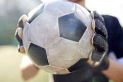 Close up of goalkeeper with ball playing football Stock Photography