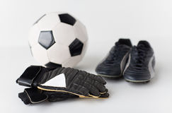 Close up of goalkeeper gloves, ball, soccer boots Royalty Free Stock Image
