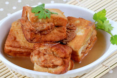 Close up of gold bar soup as fried tofu wrap minced pork in soup . Selective focus Royalty Free Stock Image