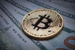 Close-up of gold bitcoin and dollars Stock Image