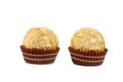 Close up of gold chocolate bonbon. Stock Images