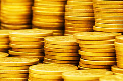 Close up of gold coin stacks. Shallow DOF royalty free stock photo