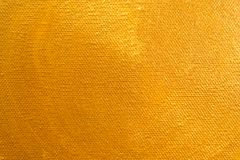 Close up Gold color paint on Painting canvas stock images