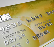 Close up of a gold credit card with silver embossed numbers Royalty Free Stock Photography
