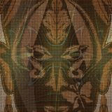 Close up of gold decorated ritual mask on canvas textured background Royalty Free Stock Image