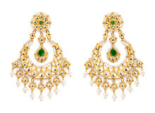 Close up of gold and diamond earrings Royalty Free Stock Photos