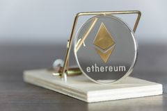 Close Up Gold Ethereum Cryptocurrency In Mouse Trap. Financial T Stock Photos