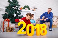 Close-up of gold figures 2018. The boy holds the number two. Stock Photo