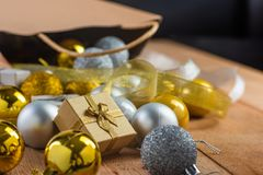 Close-up of gold gift. On wooden table, twinkle bokeh background stock photo