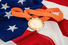 Close-up of gold medal on american flag Stock Photography