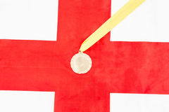 Close-up of gold medal on english flag Stock Photos