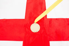 Close-up of gold medal on english flag Royalty Free Stock Images