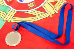 Close-up of gold medal on portugual flag Royalty Free Stock Photo