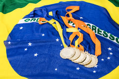 Close-up of gold medals on brazilian flag Stock Images