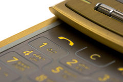 Close-up of gold mobile. Phone over white background(shallow DOF Stock Photos