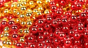 Close up of gold and red beads. Stock Image
