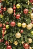 Close up of a gold and red decorated christmas tree. With glass ornaments Stock Image