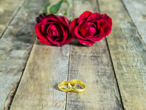 Close up gold ring and red rose on a wooden background royalty free stock photos