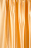 Close up of gold silk cloth texture. Stock Photography