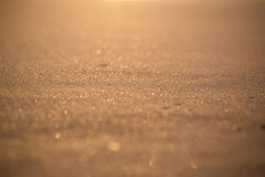 Close-up of gold sunset sunrise sand. Warm sand background texture in a sunset time. Thailand beach Royalty Free Stock Photos