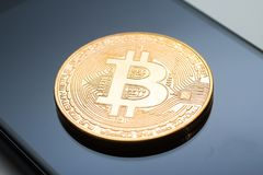 Close-up of a golden bitcoin currency Stock Photography
