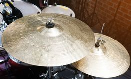 Close up of golden bronze cymbal plate of drum set on the stage stock photos