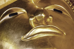 Close up of golden buddha face Royalty Free Stock Photo