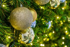Close up golden christmas ball. Hanging on the christmas tree Royalty Free Stock Photo