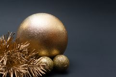 Close up of golden Christmas tree branches and baubles. Concept royalty free stock image