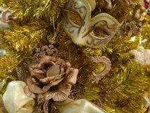Golden Christmas tree with rose and mask Royalty Free Stock Photography