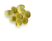 Close up golden color oil supplements in soft gel capsule, healthy product concept Stock Photos