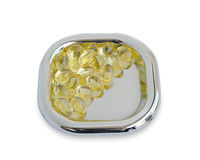 Close up golden color oil supplements in soft gel capsule, healthy product concept Stock Image