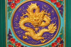 Close-up golden dragon marble carving wall, Decorative Chinese art style. At Chinese public temple Stock Photography