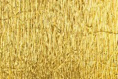 Golden foil abstract textured background. Royalty Free Stock Photos