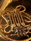 Close up of a golden french horn. A close up of a very golden, concert french horn Royalty Free Stock Photography