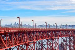 Close-up Golden Gate Bridge and San Francisco Cityscape from Marin Headlands. Colorful close-up view of the Golden Gate Bridge Steel structure with the City of royalty free stock images