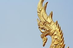 Golden Naga sculpture at temple in Thailand royalty free stock photography