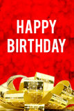 Close up Golden present  with big bow and Happy Birthday word at Stock Photos