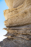 Close up of golden rock with clear blue sky. In Sardinia royalty free stock photo