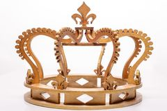 Close-up of golden royal crown on white background.  stock images