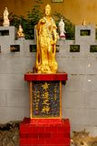 Close up of golden statue in Tin Hau Temple Repulse Bay in Hong. Kong royalty free stock photo