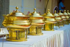 Close up of golden structures put in a raw over a table with white fabric, in City Palace in Jaipur, India.  Stock Images