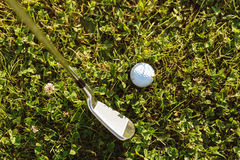 Close-up of golf ball with golf club before tee off Royalty Free Stock Image