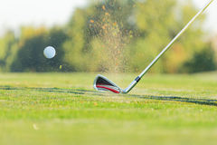 Close-up of golf ball with club Stock Photography